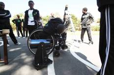 Wheelchair user leaning about optics