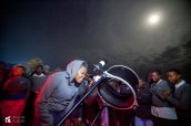 Student observing craters on the Moon